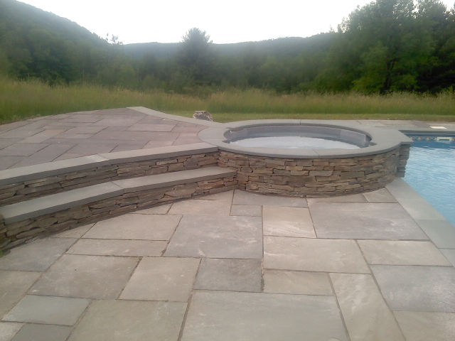 """Natural Cleft Full Color Multiple Pattern Decking, Thermal Poll & Spa Coping & 4"""" Ashlar Veneer Wall"""