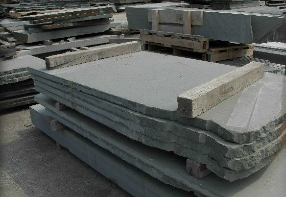 Flamed slabs prior to dimensional fabrication