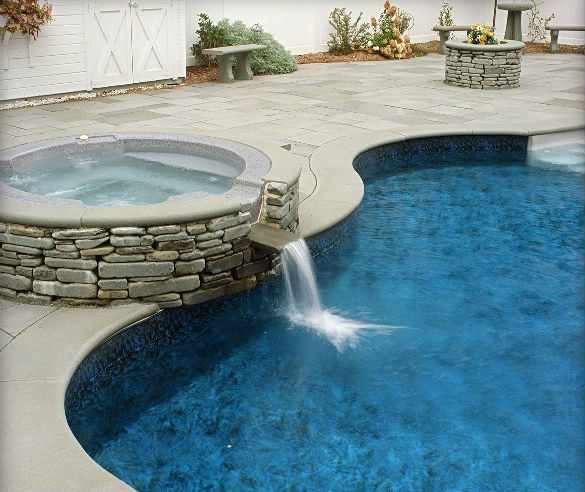 Blue Thermal Finish Radial Bullnose Coping, Blue Thermal Finish Paving, & Tumbled Veneer Stone